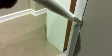 Photo 9. Sealing the Connection of Wall and Moulding